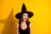 Photo Of Charming Pretty Young Lady Smiling Red Bright Lipstick Flirty Look Attracting Handsome Boyfriend Wear Black Witch Costume Cone Headwear Isolated Yellow Color Background