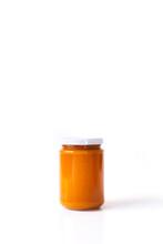 Homemade Apricot Jam. Homemade Apricot Jam In A Glass Against A White Background.  Marillenmarmelade Selbst Gemacht. Selbstgemachte Aprikosen-Konfitüre Im Glas Vor Weißem Hintergrund.