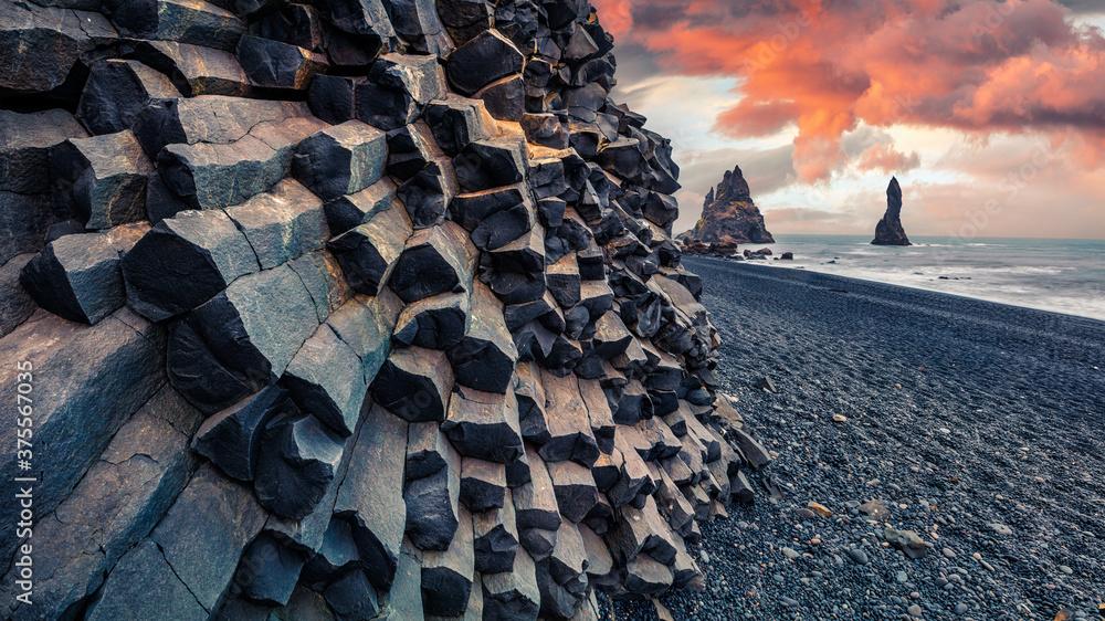 Fototapeta Unbelievable sunset on Reynisdrangar cliffs in Atlantic ocean. Spectacular summer scene of black sand beach in Iceland, Vik location, Europe. Beauty of nature concept background.