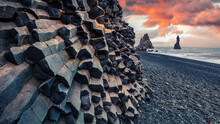 Unbelievable Sunset On Reynisdrangar Cliffs In Atlantic Ocean. Spectacular Summer Scene Of Black Sand Beach In Iceland, Vik Location, Europe. Beauty Of Nature Concept Background.