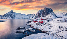 Magic Sunset On Popular Tourist Destination - Hamnoy Port With Festhaeltinden Mount On Background, Norway. Amazing Evening Scene Of Lofoten Islands. Incredible Winter Seascape Of Norwegian Sea.