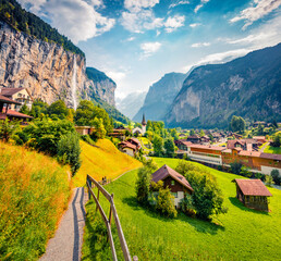 Captivating summer view of Lauterbrunnen village. Amazing morning scene of Swiss Alps, Bernese Oberland in the canton of Bern, Switzerland, Europe. Artistic style post processed photo.