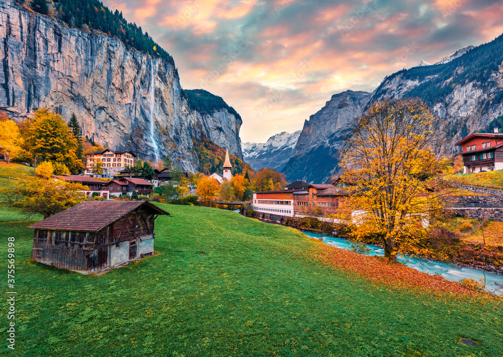 Fototapeta Fabulous outdoor scene of Swiss Alps, Bernese Oberland in the canton of Bern, Switzerland, Europe. Captivating autumn sunrise in Lauterbrunnen village. Beauty of countryside concept background.
