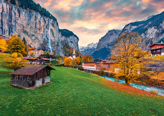 Fabulous outdoor scene of Swiss Alps, Bernese Oberland in the canton of Bern, Switzerland, Europe. Captivating autumn sunrise in Lauterbrunnen village. Beauty of countryside concept background.