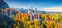 Panoramic View From Flying Drone Of Neuschwanstein Castle, 19th-century Hilltop Fairytale Castle. Exciting Scene Of Bavaria. Magnificent Landscape Of Alps, Germany. Traveling Concept Background.