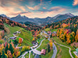 Leinwanddruck Bild Fantastic evening view from flying drone of Maria Gern church with Hochkalter peak on background. Incredible autumn scene of Bavarian Alps. Colorful landscape of Germany countryside.