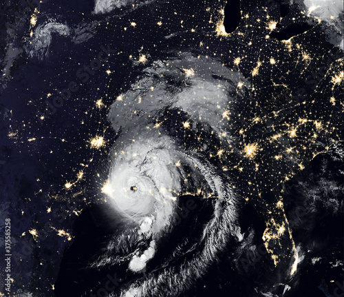 Storm Laura over USA at night, view of tropical hurricane eye from space. Elements of this image furnished by NASA.