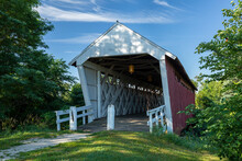 A Red And White Covered Bridge.