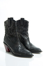 Fashionable Female Black Leather Cowboy Boots Isolated On A White Background.