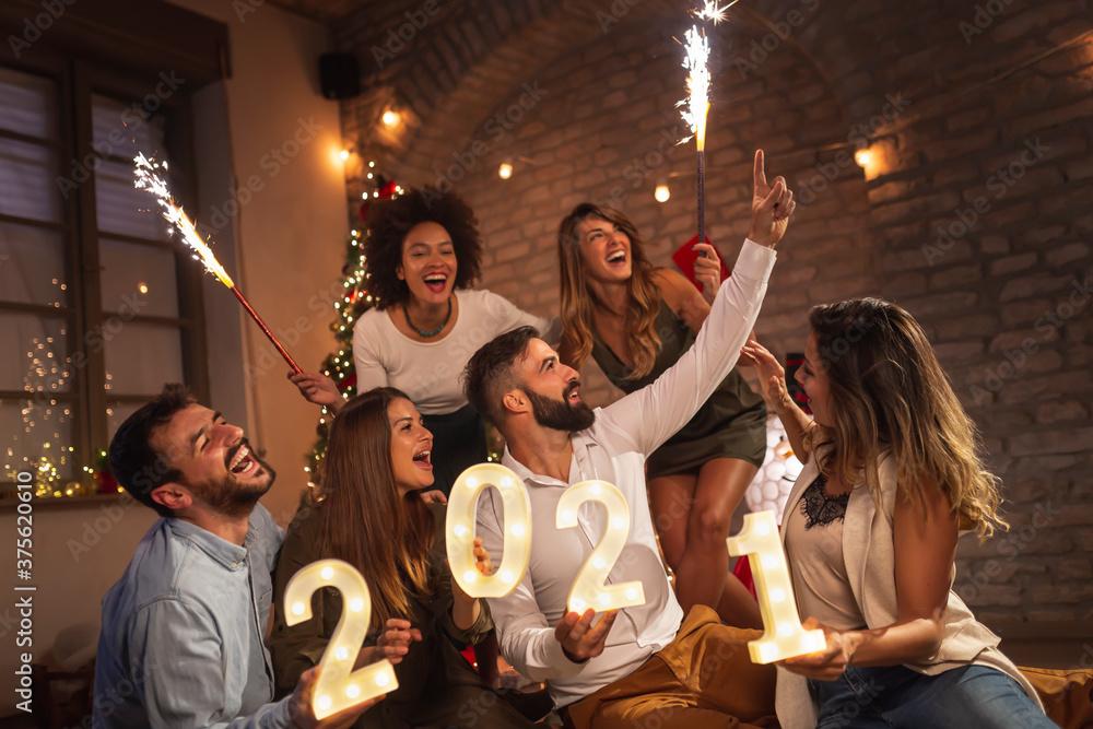 Fototapeta Friends having fun at New Year's midnight countdown