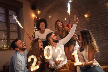 Friends having fun at New Year's midnight countdown