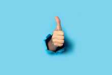 Male Hand Makes A Hand Up Gesture On A Blue Background. Banner. Gesture All Ok, Like
