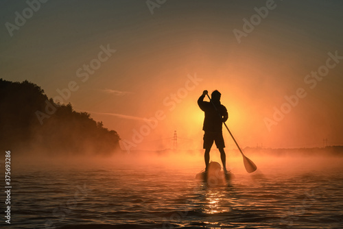 man paddling on the river in fog Canvas Print