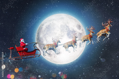 Obraz Santa claus in a sleigh ready to deliver presents with sleigh - fototapety do salonu
