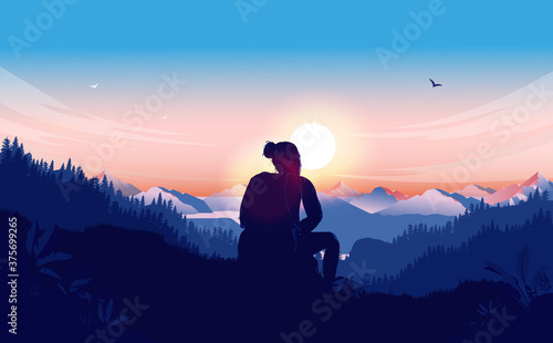 Fotografia Relax in nature - Woman sitting alone on hilltop watching the beautiful view of landscape