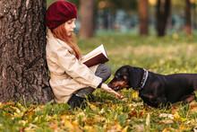 A Cute Little Girl Is Reading ...