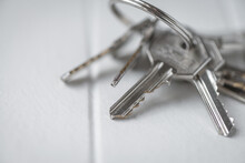 Silver Keys On A White Timber Benchtop