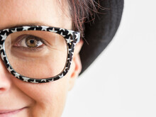Closeup Of Woman With Starry Glasses
