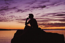 Young Man Thinking About Life, At Calm Ocean