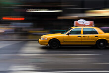 Yellow Taxi In Motion On A Cit...