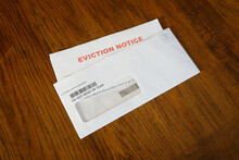 Close-up Of An Eviction Notice In Envelope On Desk