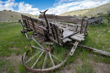 Broken, Busted Wagon In The Grass At Bannack Ghost Town In Montana
