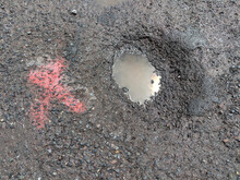 Asphalt Pothole Filled With Di...