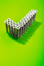 Check Sing Shaped With Lot Of Screws On Green Background. Social Media Icon.