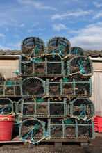 Lobster, Crab And Crayfish Traps Stacked To Dry Outside A Fisherman's Hut