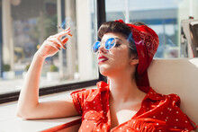 Young Rockabilly Pin Up Woman Smoking Cigarette And Relaxing.