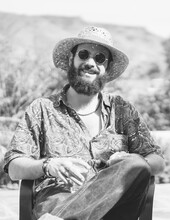 Hipster With Straw Hat Smiling
