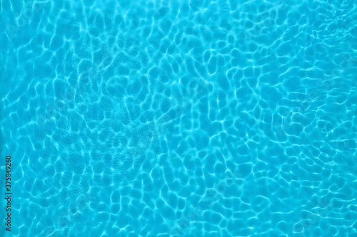 Pure water with ripples in swimming pool Wallpaper Mural