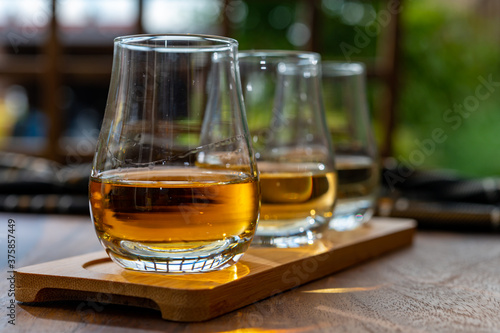 Tasting of Scotch whisky in traditional old British house with wooden windows