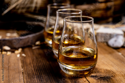 Fotomural Speyside scotch whisky tasting on old dark wooden vintage table with barley grai