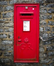 Red English Letterbox On Old W...