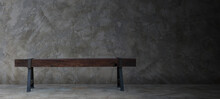Old Wooden Bench In A Room With Concrete Floor And Concrete Wall.