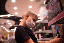 A Young Boy Looks At Toys On Display At A Toy Store In A Shopping Mall