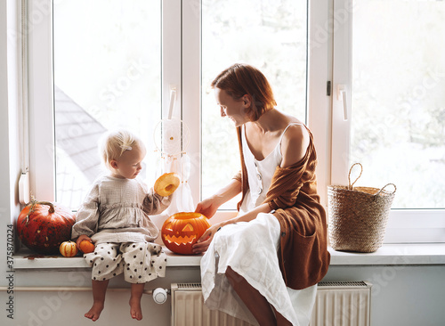 Happy family preparing for Halloween at home together. Fotobehang
