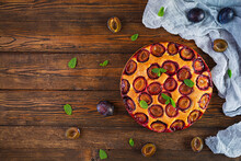 Delicious Homemade Plum Pie On Rustic Background. Top View