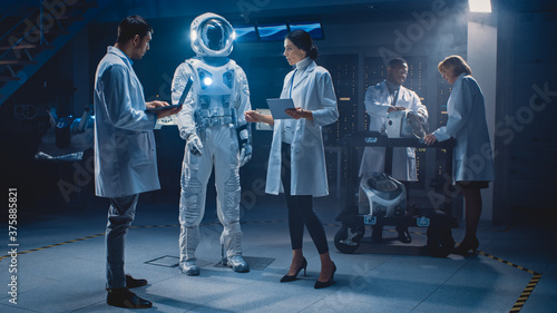 Fototapeta Team of Aerospace Engineers Design New Space Suit Adapted for Galaxy Exploration and Travel