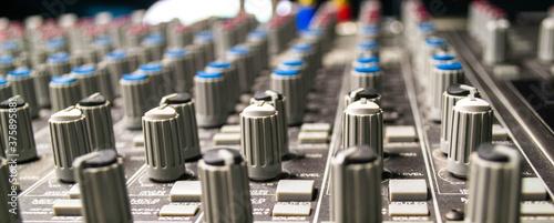 Closeup of audio mixing console Wallpaper Mural