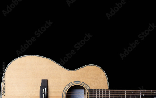 classic steel string acoustic guitar on a black background with copy space Wallpaper Mural