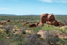 Devils Marbles Overview On Green Field. Sacred Aboriginal Place With Massive Granite Boulders. Symbol Of Australia's Outback. Aboriginal Name Karlu Karlu (round Boulders). Tennant Creek, Australia
