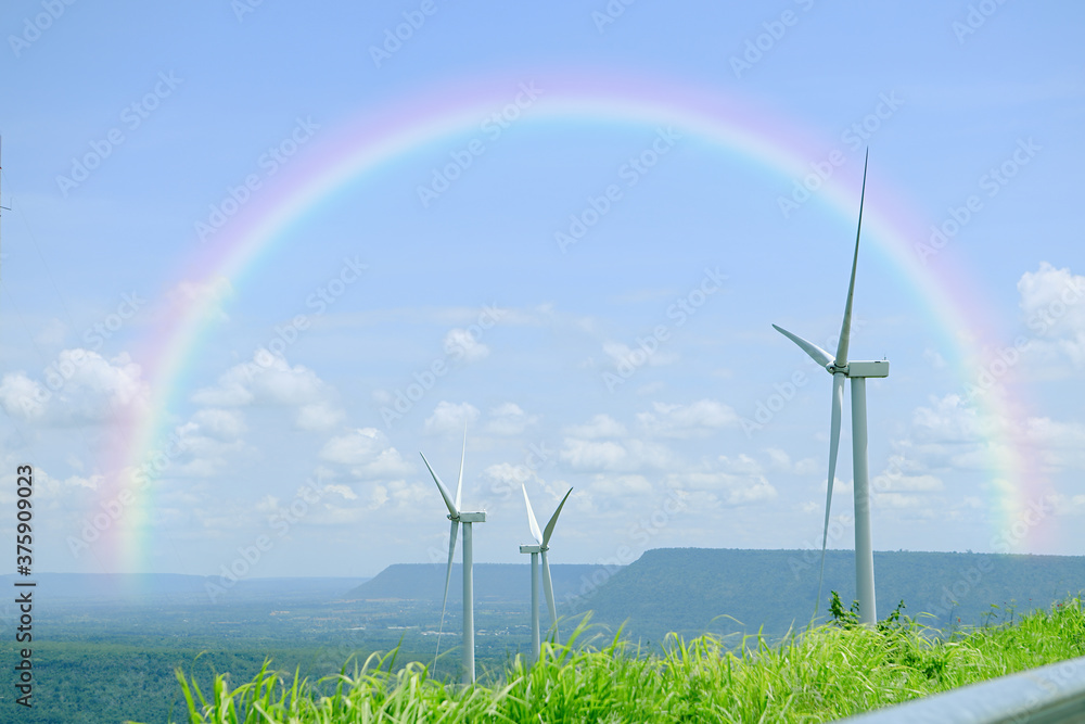 Fototapeta Wind turbines for electricity generation located near the hills to produce clean energy.