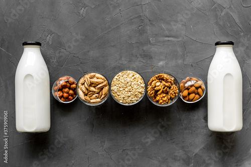 Bottles of non-dairy vegan milk - lactose free nuts and grain drink Fotobehang