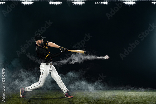 Fotografie, Tablou Baseball player with bat taking a swing on grand arena
