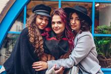 Three Young Women Friends Hugg...