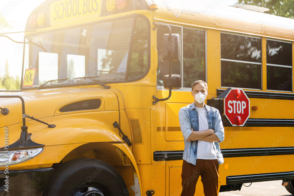 Fototapeta masked bus driver looking at camera outside the elementary school