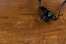 View Of A Camera On Wood Table...