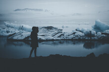 Silhouetted Figure On Glacier ...
